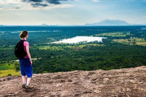 Tourist admiring the landscape of Sri Lanka from Pidurangala Rock, North Central Province, Sri Lanka